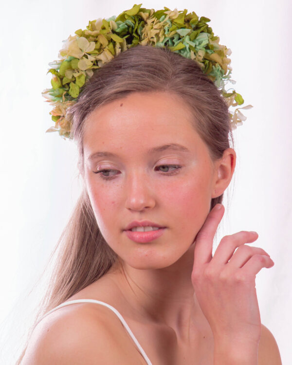 Corona de flores preservadas verde